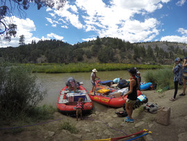 Multi day trip with Santa Fe Rafting anchoring their boats on the Rio Chama