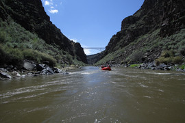 Rafting on theTaos Box rowing under the Taos Junction Bridge