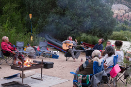 Joe West playing music on the Rio Chama with Santa Fe Rafting
