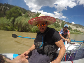 Go Pro Photo of the Bartender and Remi on the Rio Chama rowing sombraro