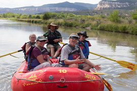 Beautiful group of people on the river with Santa Fe Rafting