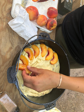 Cooking Peach Cobbler Cake Dessert for guests on our glaming trips down the river