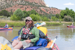 John Adams relaxing on the Over night multi day river trip with Santa Fe Rafting New Mexico River Adventures Best River Guides in Taos Santa Fe