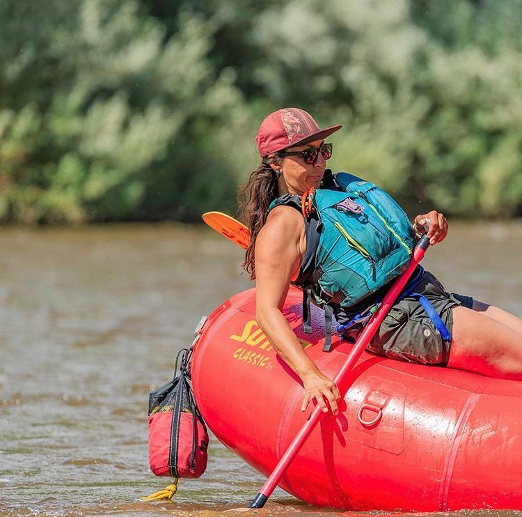 Cassandra Perez training to guide the Taos Box Canyon River section. Class four rapids in New Mexico. Outdoor high adventure activities in New Mexico.
