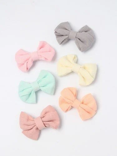 100% Cotton fabric bow on a clip