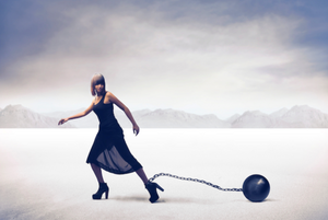 woman with ball and chain attached to her lef