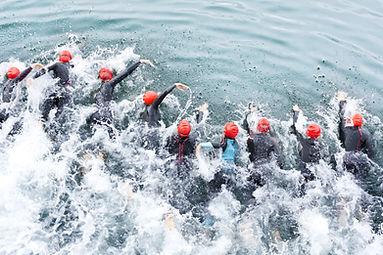 triathlon competitors in swim , triathl