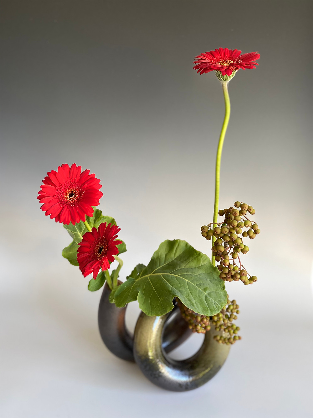 Japanese ikebana with spiral vase.