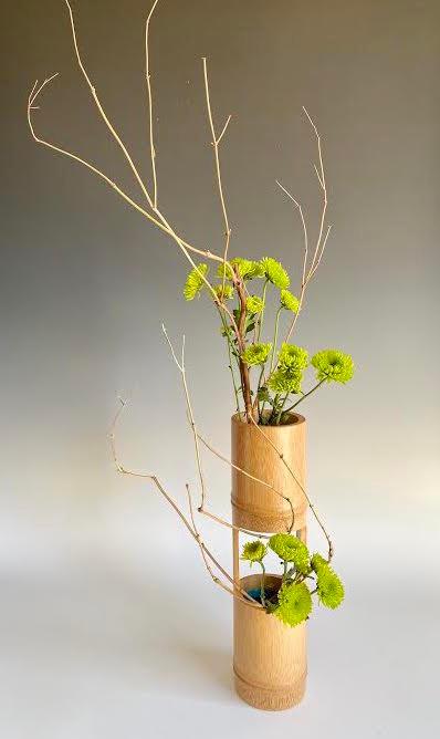 Japanese ikebana with bamboo vase.
