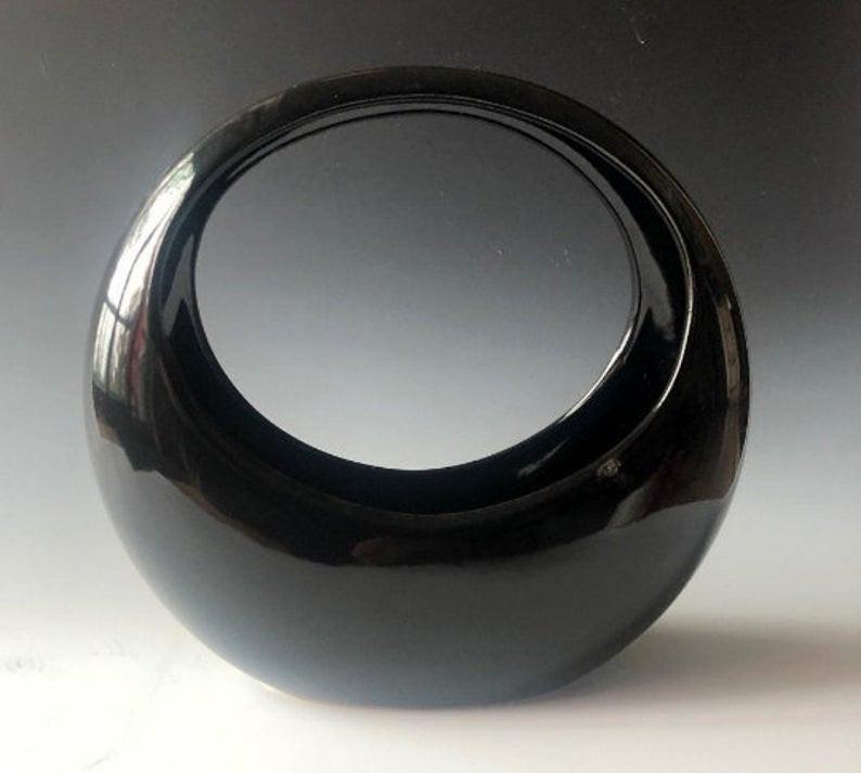 Full-moon or basket-shaped vase for Ikebana.