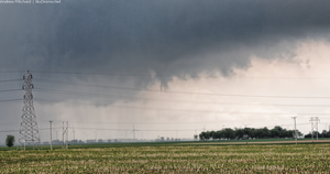 Funnel cloud (dead center) from a storm interacting with an outflow boundary on May 30th 2015. St. Joseph, IL