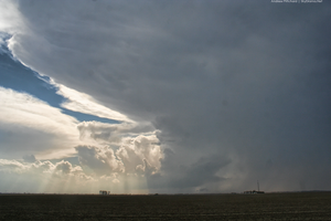 Distant supercell as viewed from near Quincy, IL as it was still across the river in eastern Missouri on April 9th 2015. A large EF4 tornado struck Fairdale/Rochelle on this day further north.