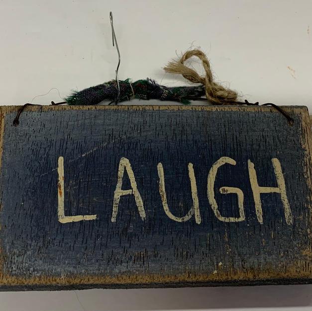 Blue Laugh Sign