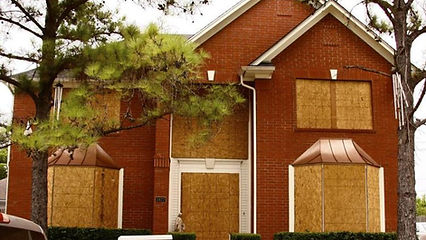 house-windows-boarded-up-900x506.jpg