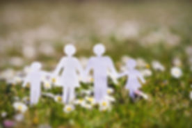Paper cut of family with flowers background on a green grass.Family Life Insurance.Protecting family