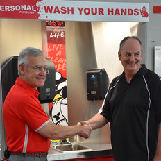 Personal Protected Owner and President Jim Tressel shake hands