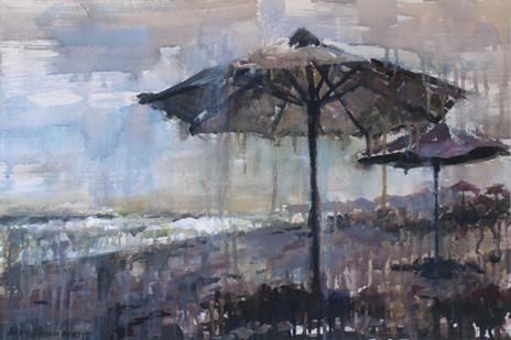 Lonely beach umbrellas.