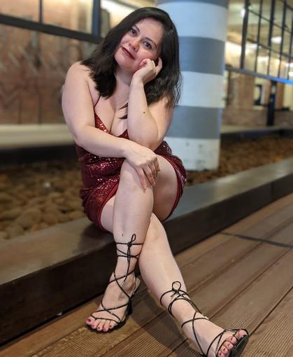 1feistycookie sitting red dress.jpg