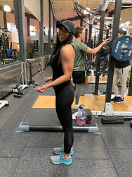 MuscleMakerSue's client proudly showing her muscles.