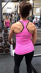 MuscleMakerSue training Natalie on shoulder front raises, but had to take a pic of her back. Awesome!