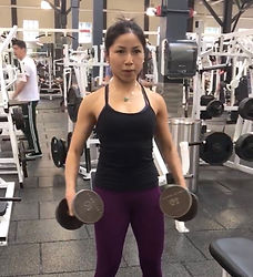 MuscleMakerSue training client on lateral raise.
