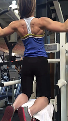 MuscleMakerSue training client on assisted chins.