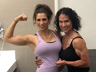 MuscleMakerSue and client Natalie showing off our biceps.