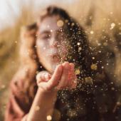 Woman-Blowing-Glitter-Sun.png