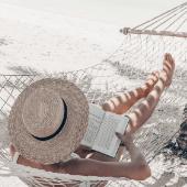 Woman-Hat-Beach-Sand-Hammock-Reading.png