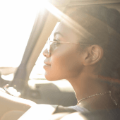 Woman-Sunglasses-Sunlight-Driving-Lookin