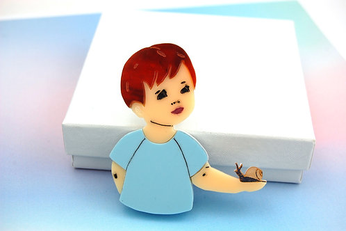 Little Boy holding a Snail Acrylic Brooch