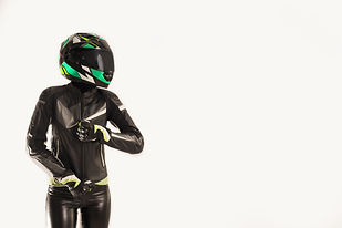 woman in Motorcycle suit dressing up Mot