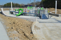 View showing how the play equipment fits in the play space. Poured-in-place rubber play surface coming soon!
