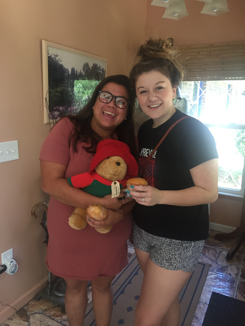2 young women holding Paddington bear at the Little English Guesthouse