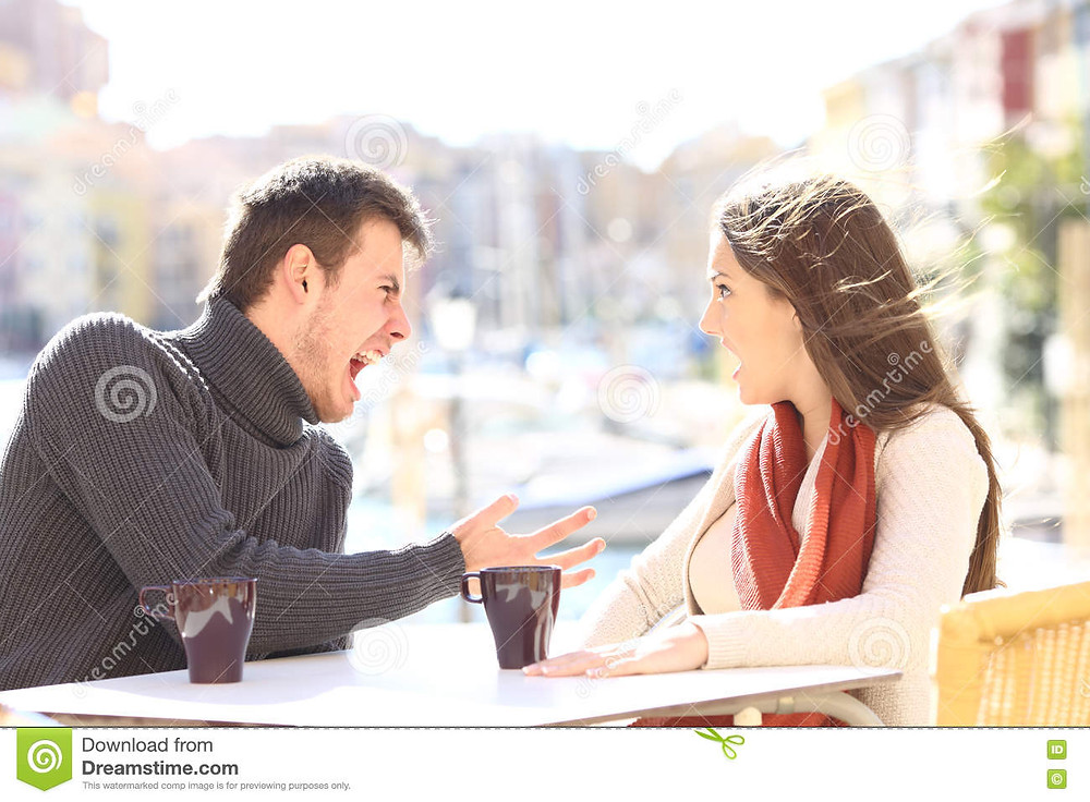Couple arguing in a public restaurant