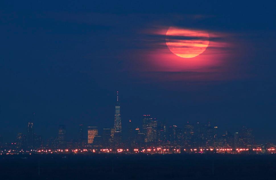 Super Snow Moon over Manhattan skyline
