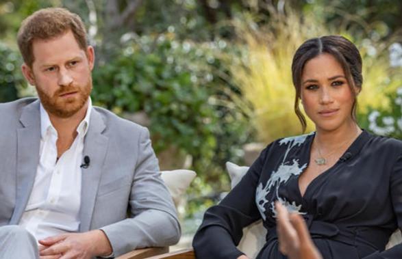 Meghan and Prince Harry looking at Oprah