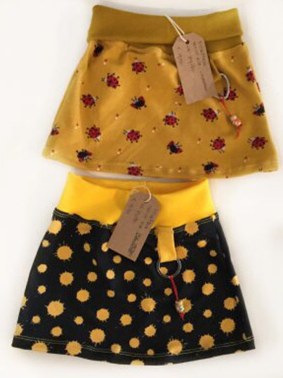 Tricot rok, zwart+gele spatters