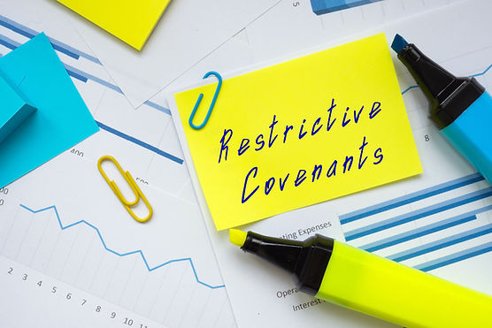 Conceptual photo about Restrictive Covenants with written phrase. _.jpg