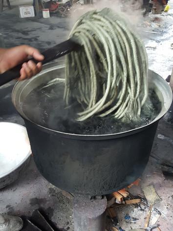 Bound yarns being soaked in hot bath dye
