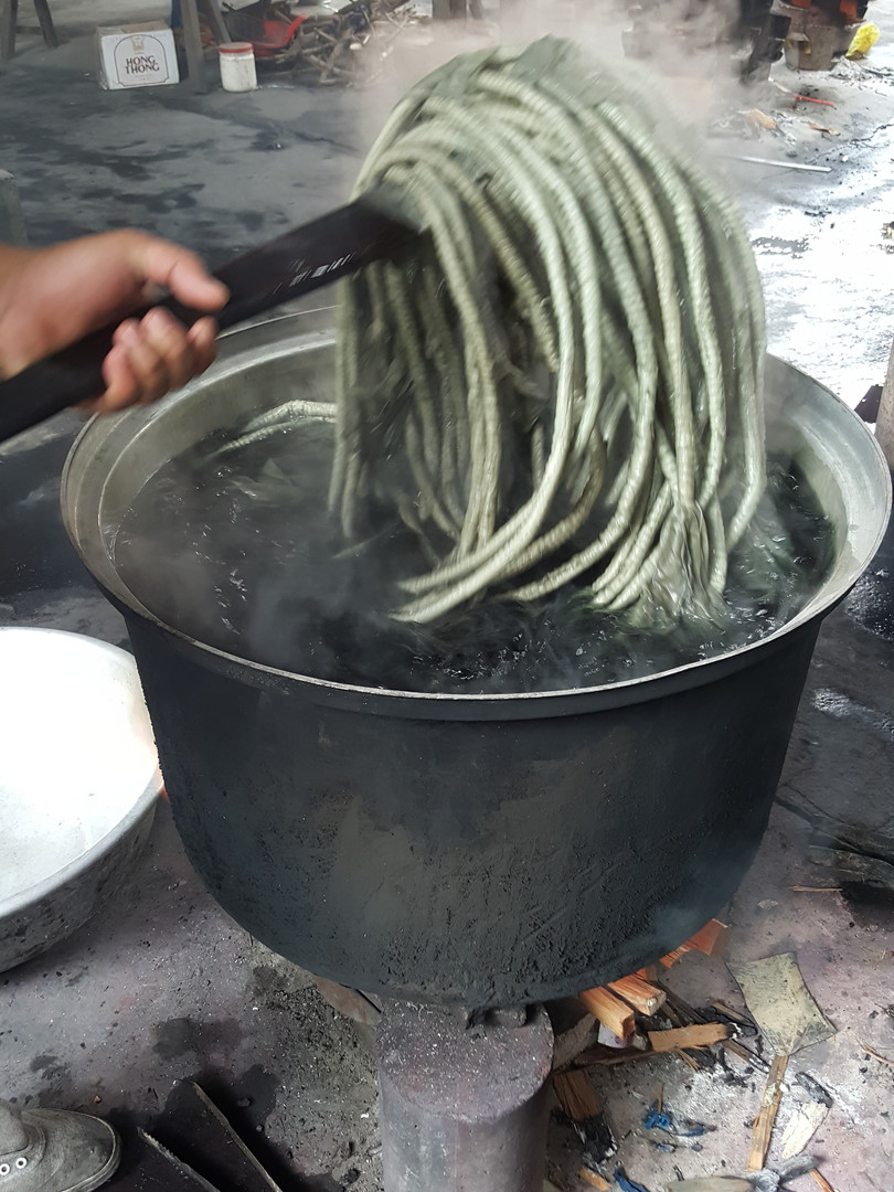 Bound yarns being soaked in hot bath dye