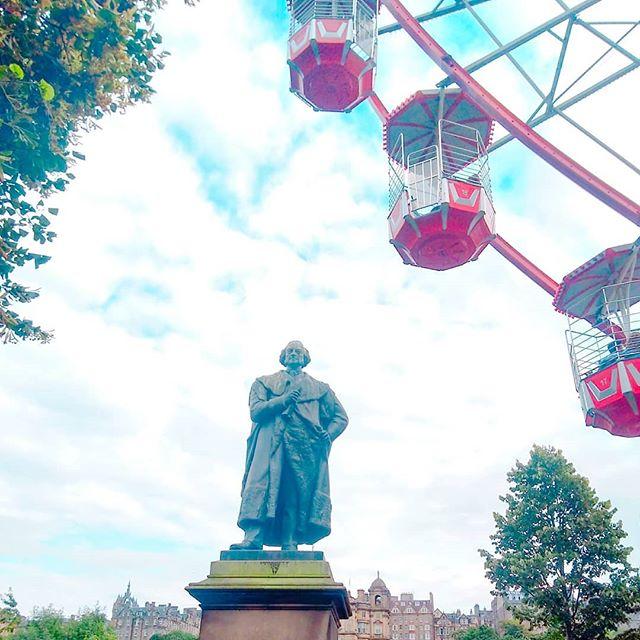 Statue of Adam Black and a Ferris wheel. I apologize for the half assed description. ._._