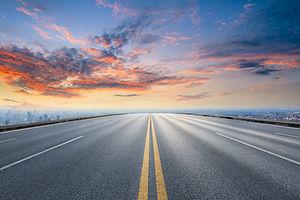 Empty asphalt road and modern city skyli