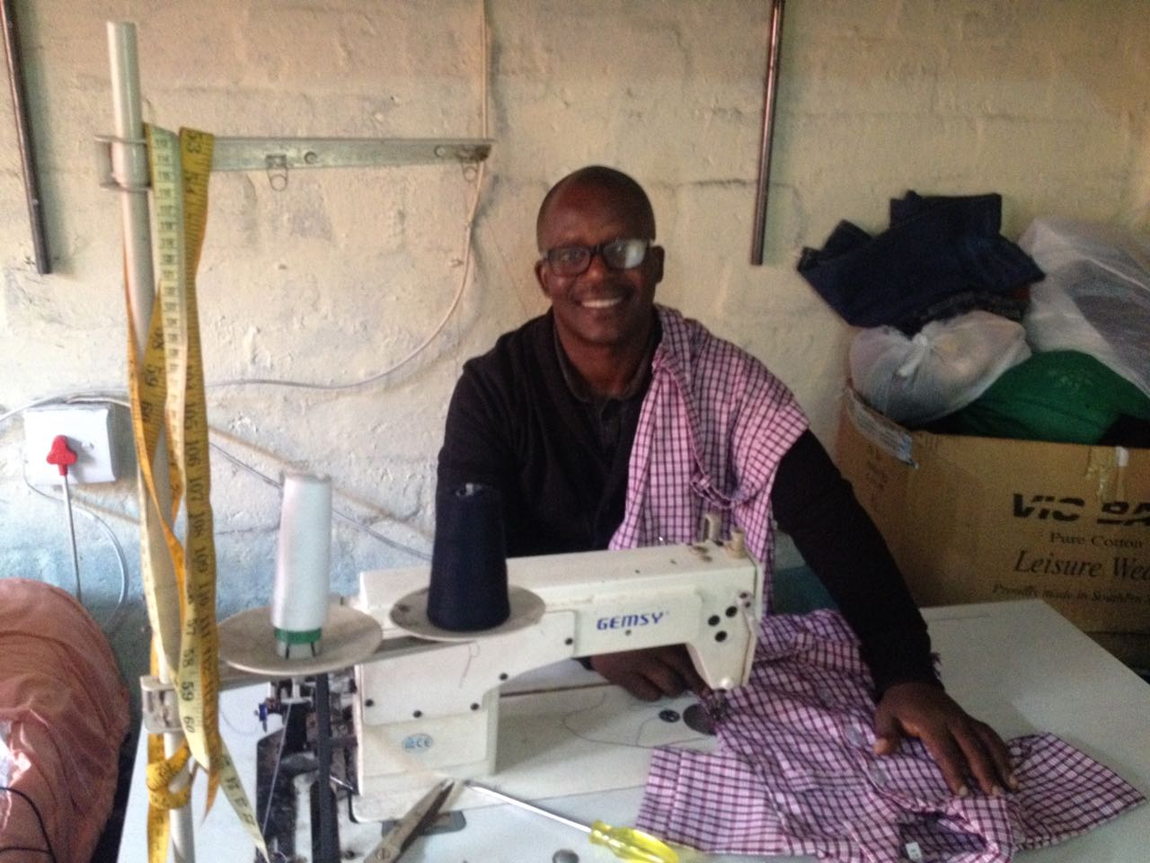 Nomha, Project Coordinator with local uniform maker in Nyanga, Cape Town