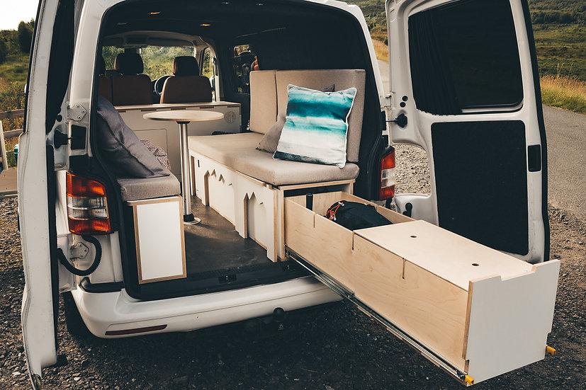 Torridon: Unequel split sliding bed with extending storage / cook station