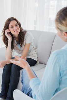 Happy woman sitting with her therapist t