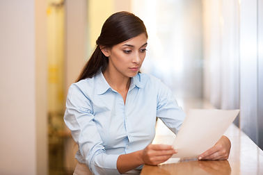 Young Attractive Woman Reading Document