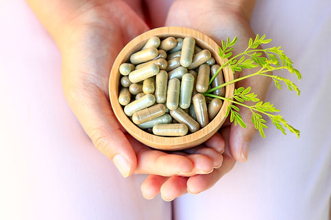 Girl hands holding herbal capsules in wo