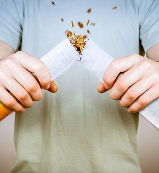Quit smoking - male smoker breaking gian