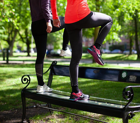 Personal trainer training in the park near client's home